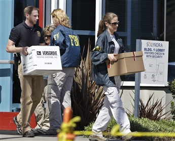 FBI agents remove evidence from Solyndra Headquarters
