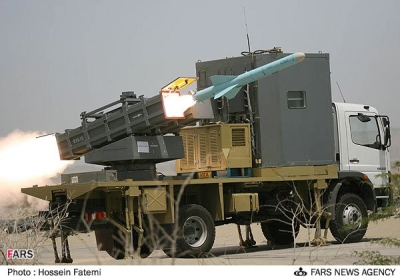 Firing a Chinese-manufactured C-802 anti-ship cruise missile