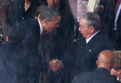 Obama shakes hands with communist dictator Castro
