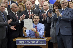Scott Walker signs right-to-work law