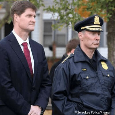 District attorney John Chisholm (left)