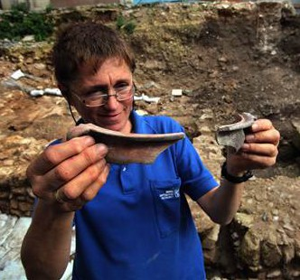 Israeli archaeologist Yardena Alexandre inspects Roman 1st-century pottery found from the city of Nazareth.