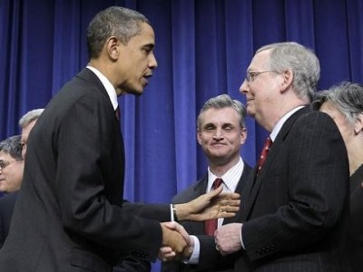 Mitch McConnell shaking hands with his buddy Obama