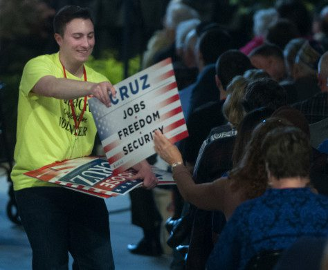 Cruz volunteer hands out signs at the Maine GOP Convention