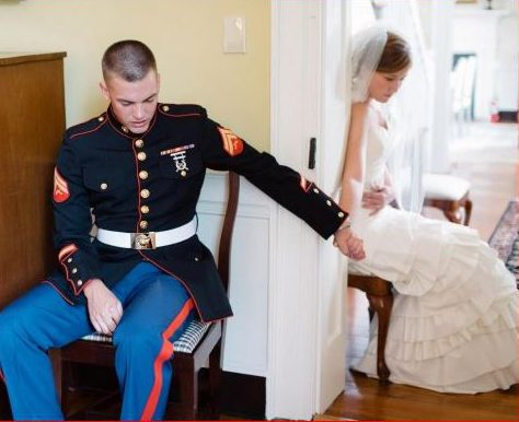 Marine prays with his wife on their wedding day