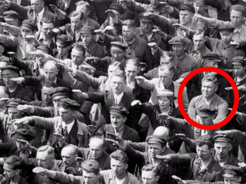 ... single, solitary man refuses to salute Hitler at a Nazi party rally