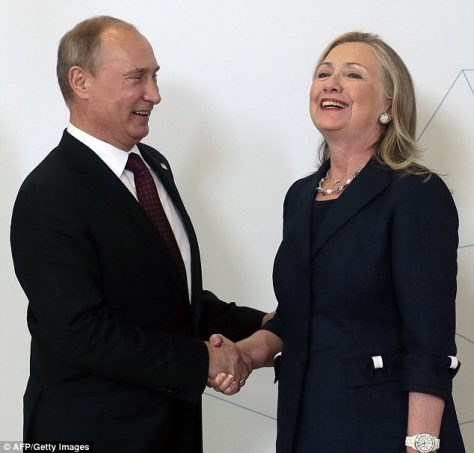 Hillary Clinton and Vladimir Putin shake hands, such a happy occasion