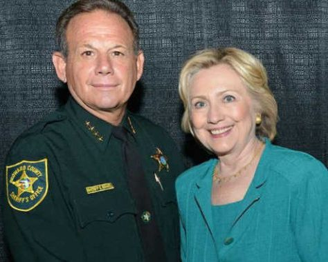 Image result for Hillary Clinton shaking hands with Parkland Florida Sheriff