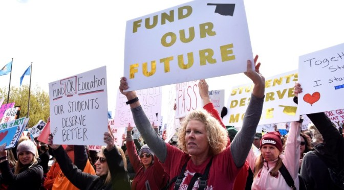 When I want a raise, I work harder, but these teachers hold up signs