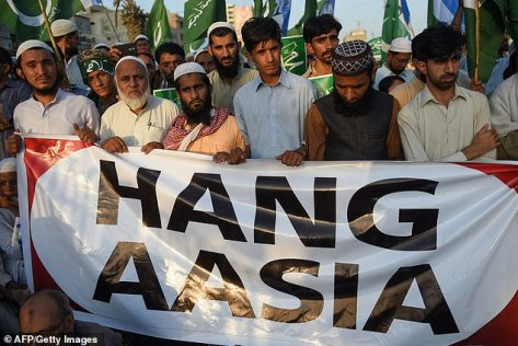 "The sign the Pakistani men are holding should read ""Hang Asia"""