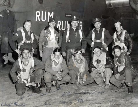 Roger Trimble, standing second from the left, in front of his B-24 Liberator