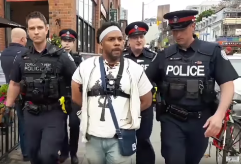 Four white Canadian police officers arrest black pastor