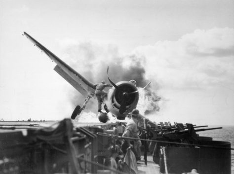 Lt. Walt Chewning charges unto burning F-6F Hellcat to save trapped pilot